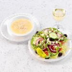 large greek salad bowl of avgolemono soup with white wine 150x150
